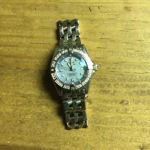 Breitling Woman's 18k and Diamond watch heavy!